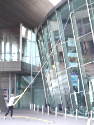 Look at the size of that squeegee - a man cleaning the windows at the Lowry Centre. Clicking here takes you to my gallery of Lowry Centre pics